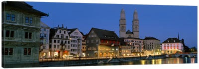 Buildings at the waterfront, Grossmunster Cathedral, Zurich, Switzerland Canvas Art Print