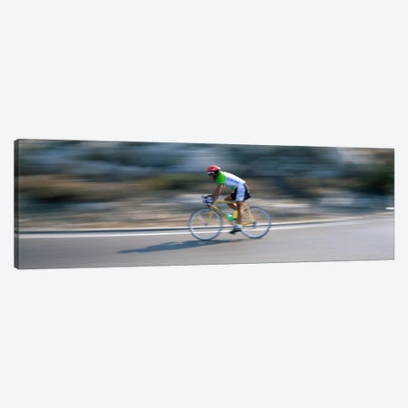 Bike racer participating in a bicycle raceSitges, Barcelona, Catalonia, Spain Canvas Print #PIM2137} by Panoramic Images Canvas Artwork