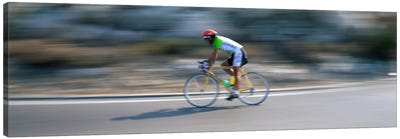 Bike racer participating in a bicycle raceSitges, Barcelona, Catalonia, Spain Canvas Art Print
