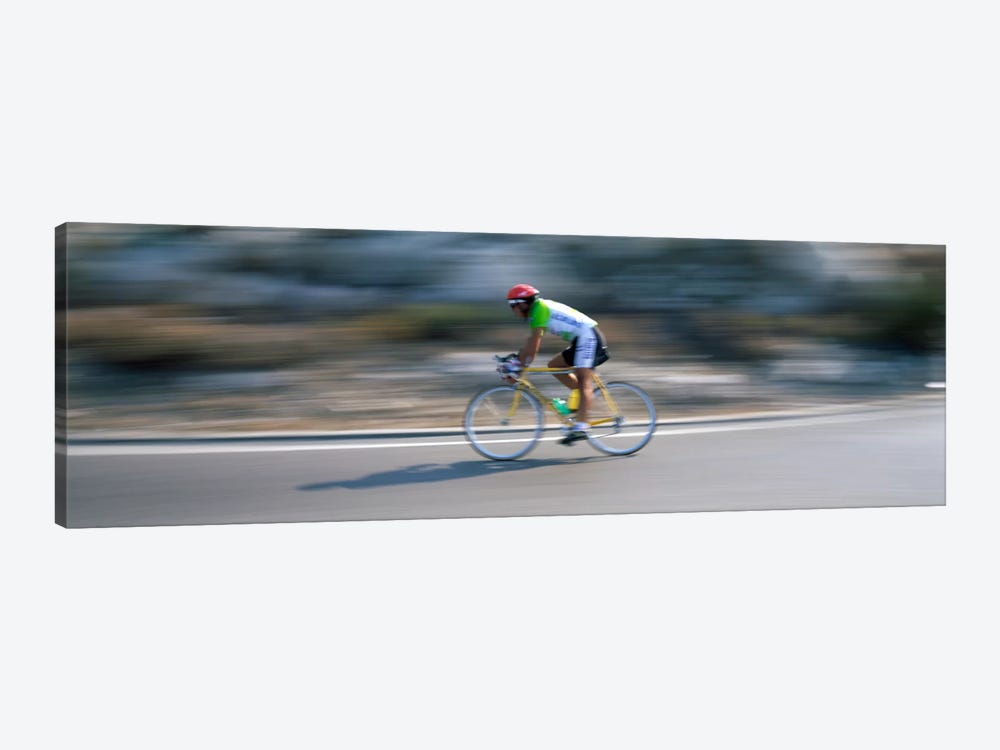 Bike racer participating in a bicycle raceSitges, Barcelona, Catalonia, Spain by Panoramic Images 1-piece Art Print