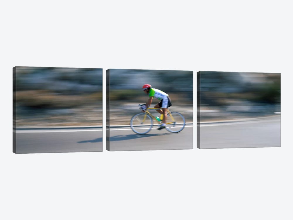 Bike racer participating in a bicycle raceSitges, Barcelona, Catalonia, Spain by Panoramic Images 3-piece Canvas Art Print
