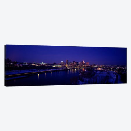 Reflection of buildings in a river at nightMississippi River, Minneapolis & St Paul, Minnesota, USA Canvas Print #PIM2174} by Panoramic Images Canvas Art