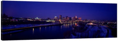 Reflection of buildings in a river at nightMississippi River, Minneapolis & St Paul, Minnesota, USA Canvas Art Print