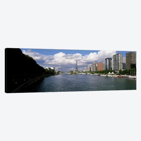 Distant View Of The Eiffel From The Seine River, Paris, France Canvas Print #PIM2207} by Panoramic Images Canvas Wall Art