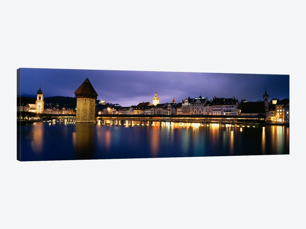 Buildings lit up at dusk, Chapel Bridge, Reuss River, Lucerne, Switzerland by Panoramic Images 1-piece Canvas Print