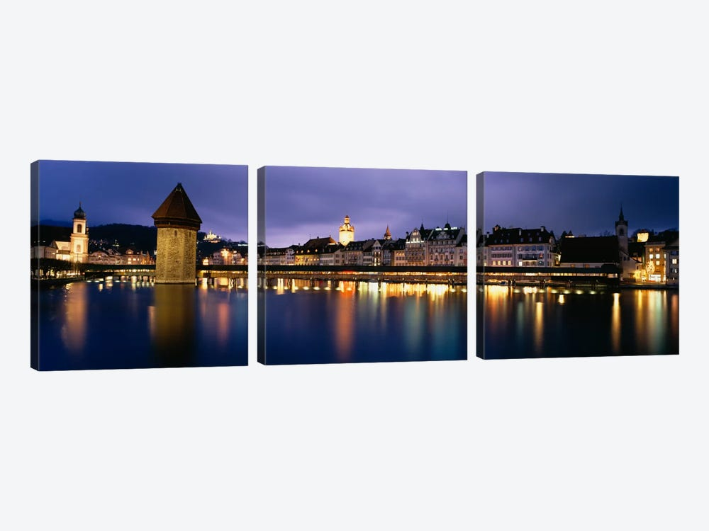 Buildings lit up at dusk, Chapel Bridge, Reuss River, Lucerne, Switzerland by Panoramic Images 3-piece Canvas Print