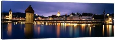 Buildings lit up at dusk, Chapel Bridge, Reuss River, Lucerne, Switzerland Canvas Art Print