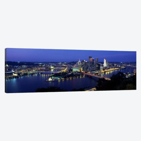 Buildings along a river lit up at dusk, Monongahela River, Pittsburgh, Allegheny County, Pennsylvania, USA Canvas Print #PIM2219} by Panoramic Images Canvas Wall Art
