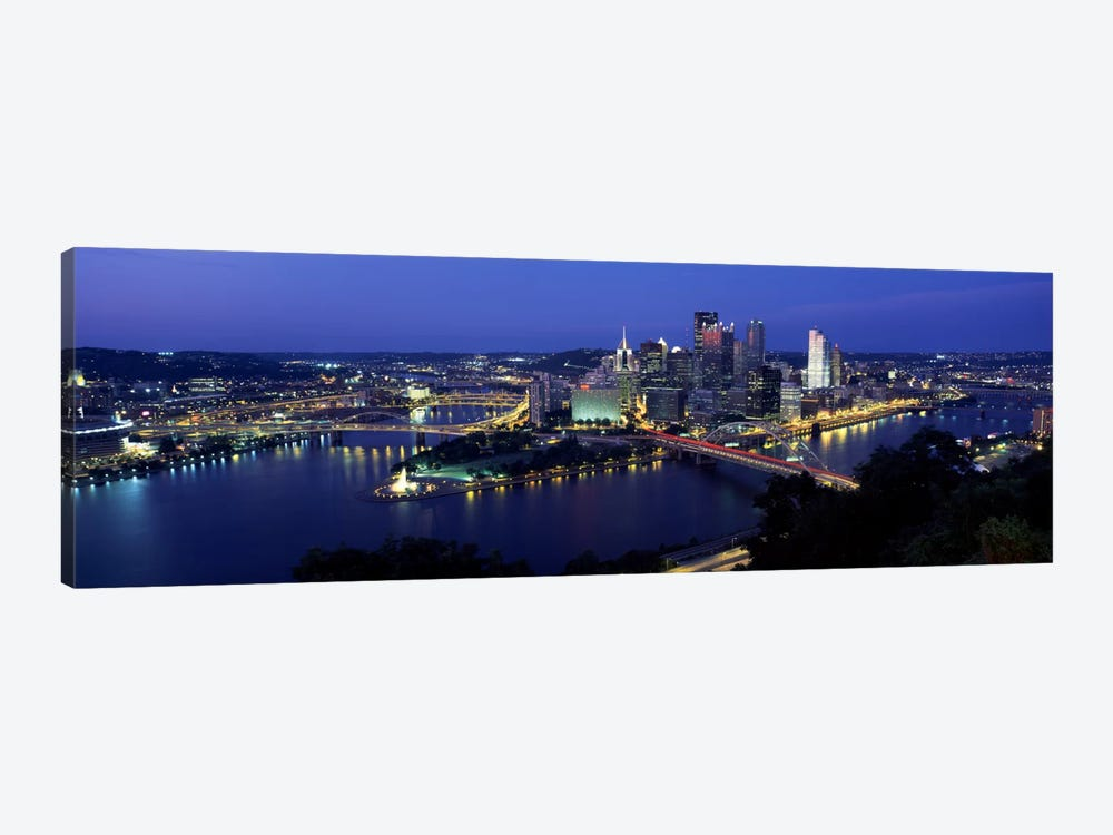 Buildings along a river lit up at dusk, Monongahela River, Pittsburgh, Allegheny County, Pennsylvania, USA by Panoramic Images 1-piece Canvas Art Print