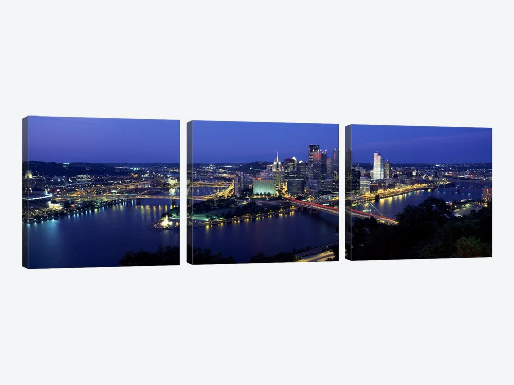 Buildings along a river lit up at dusk, Monongahela River, Pittsburgh, Allegheny County, Pennsylvania, USA 3-piece Canvas Print
