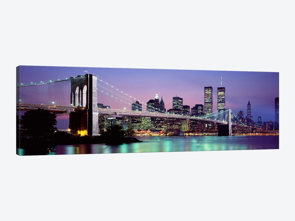 An Illuminated Brooklyn Bridge With Lower Manhattan's Financial District Skyline In The Background, New York City, New York  by Panoramic Images 1-piece Canvas Print