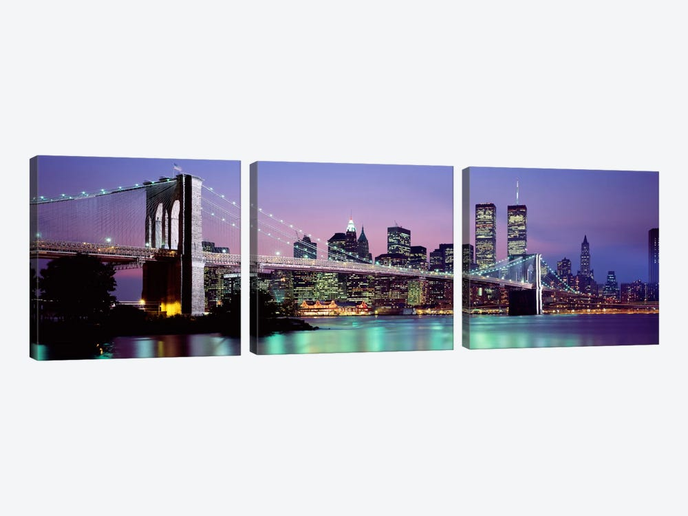 Bridge across a river lit up at dusk, Brooklyn Bridge, East River, World Trade Center, Wall Street, Manhattan, New York City, Ne by Panoramic Images 3-piece Canvas Art Print
