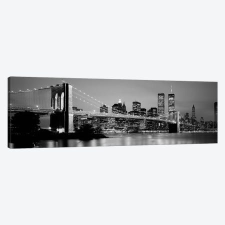 Illuminated Brooklyn Bridge With Lower Manhattan's Financial District Skyline In The Background In B&W, New York City, New York  Canvas Print #PIM2259bw} by Panoramic Images Canvas Art