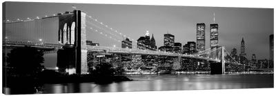 Bridge across a river lit up at dusk, Brooklyn Bridge, East River, World Trade Center, Wall Street, Manhattan, New York City, New York State, USA (black & white) Canvas Print #PIM2259bw