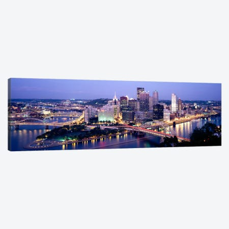 Buildings in a city lit up at dusk, Pittsburgh, Allegheny County, Pennsylvania, USA Canvas Print #PIM2260} by Panoramic Images Canvas Print
