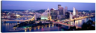 Buildings in a city lit up at dusk, Pittsburgh, Allegheny County, Pennsylvania, USA by Panoramic Images Canvas Print
