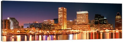Buildings lit up at dusk, Baltimore, Maryland, USA Canvas Art Print