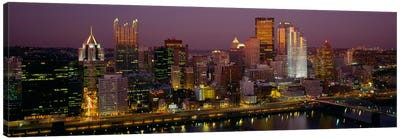 High angle view of buildings lit up at night, Pittsburgh, Pennsylvania, USA Canvas Art Print