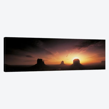 Cloudy Sunset Over The Mittens And Merrick Butte, Monument Valley, Navajo Nation, USA Canvas Print #PIM2446} by Panoramic Images Canvas Wall Art