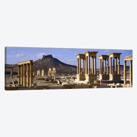 The Tetrapylon Of The Great Colonnade With A Distant View Of Fakhr-al-Din al-Ma'ani Castle, Palmyra, Homs Governorate, Syria Canvas Print #PIM2530} by Panoramic Images Canvas Print