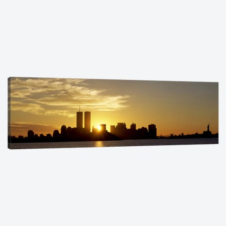 Manhattan skyline & a statue at sunriseStatue of Liberty, New York City, New York State, USA Canvas Print #PIM2640} by Panoramic Images Art Print