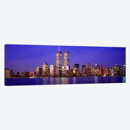 Buildings at the waterfront lit up at dusk, World Trade Center, Wall Street, Manhattan, New York City, New York State, USA Canvas Print #PIM2644} by Panoramic Images Canvas Wall Art