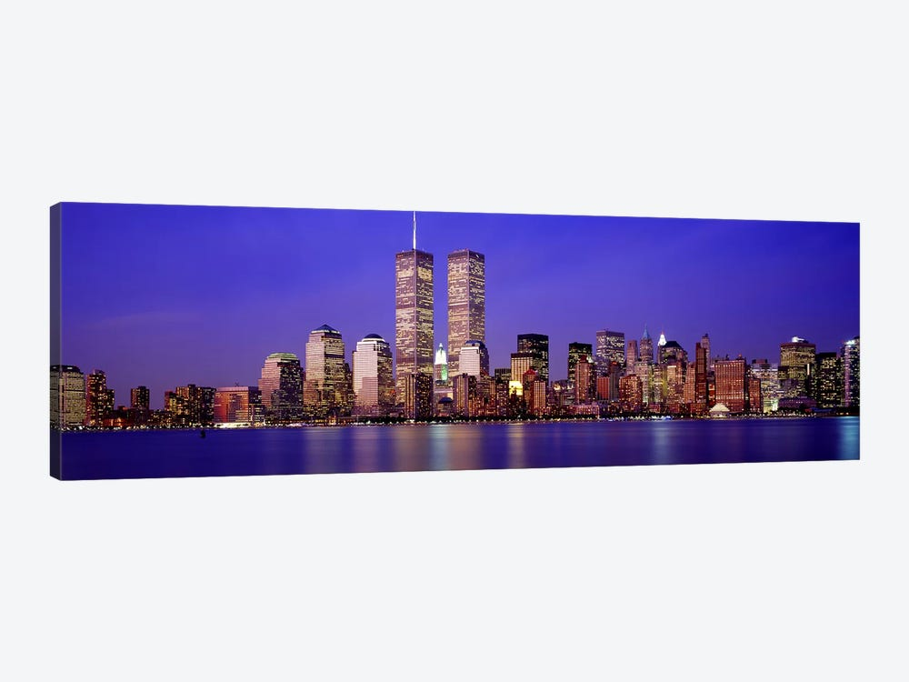 Buildings at the waterfront lit up at dusk, World Trade Center, Wall Street, Manhattan, New York City, New York State, USA by Panoramic Images 1-piece Canvas Art