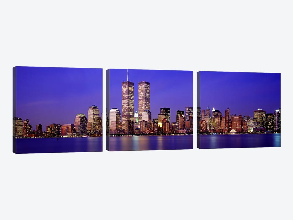 Buildings at the waterfront lit up at dusk, World Trade Center, Wall Street, Manhattan, New York City, New York State, USA by Panoramic Images 3-piece Canvas Art