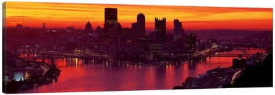 Silhouette of buildings at dawn, Three Rivers Stadium, Pittsburgh, Allegheny County, Pennsylvania, USA Canvas Art Print