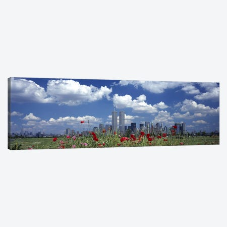 Flowers in a park with buildings in the background, Manhattan, New York City, New York State, USA Canvas Print #PIM2664} by Panoramic Images Canvas Artwork