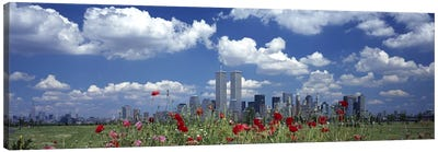Flowers in a park with buildings in the background, Manhattan, New York City, New York State, USA Canvas Print #PIM2664