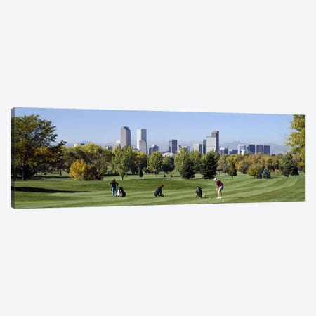 Four people playing golf with buildings in the background, Denver, Colorado, USA Canvas Print #PIM2704} by Panoramic Images Canvas Art Print