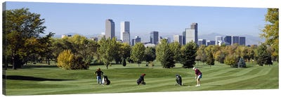 Four people playing golf with buildings in the background, Denver, Colorado, USA Canvas Art Print