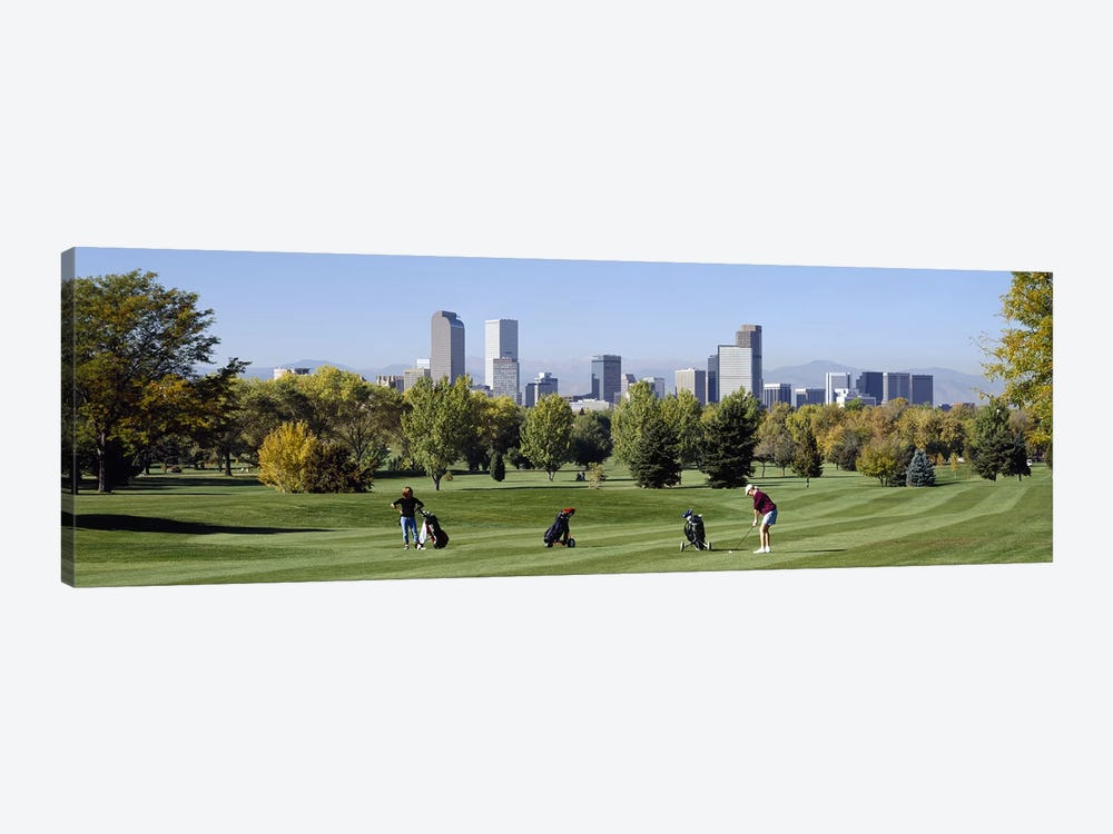 Four people playing golf with buildings in the background, Denver, Colorado, USA by Panoramic Images 1-piece Canvas Art Print