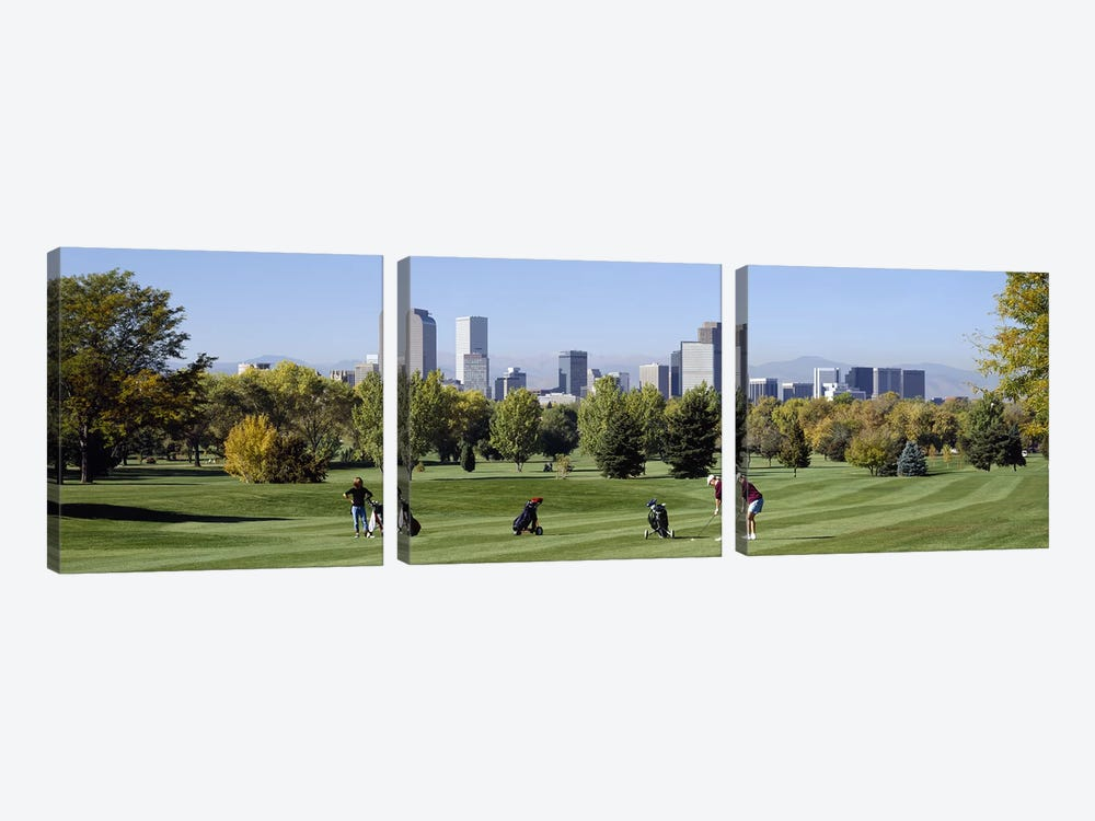 Four people playing golf with buildings in the background, Denver, Colorado, USA by Panoramic Images 3-piece Art Print
