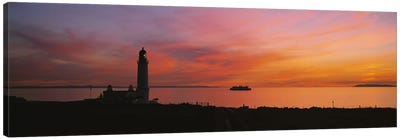 Silhouette of a lighthouse at sunset, Scotland Canvas Art Print