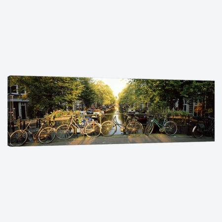 Row Of Bicycles, Amsterdam, Netherlands Canvas Print #PIM2806} by Panoramic Images Canvas Art