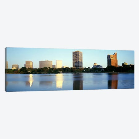 Reflection of skyscrapers in a lakeLake Merritt, Oakland, California, USA Canvas Print #PIM2894} by Panoramic Images Canvas Art Print