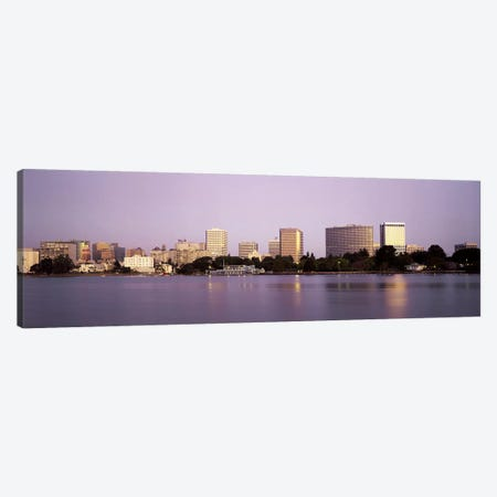 Reflection of skyscrapers in a lakeLake Merritt, Oakland, California, USA Canvas Print #PIM2895} by Panoramic Images Art Print