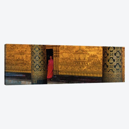 Monk in prayer hall at Wat Mai Buddhist Monastery, Luang Prabang, Laos Canvas Print #PIM2906} by Panoramic Images Canvas Art Print