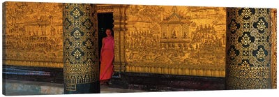 Monk in prayer hall at Wat Mai Buddhist Monastery, Luang Prabang, Laos Canvas Art Print