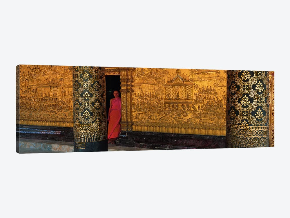 Monk in prayer hall at Wat Mai Buddhist Monastery, Luang Prabang, Laos 1-piece Canvas Wall Art
