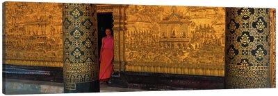 Monk in prayer hall at Wat Mai Buddhist Monastery, Luang Prabang, Laos Canvas Art Print