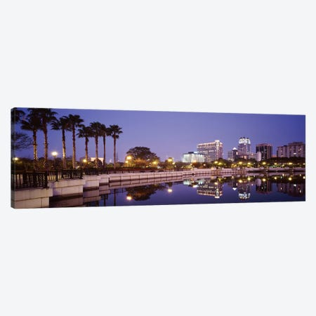 Reflection Of Buildings In The Lake, Lake Luceme, Orlando, Florida, USA Canvas Print #PIM2915} by Panoramic Images Canvas Wall Art