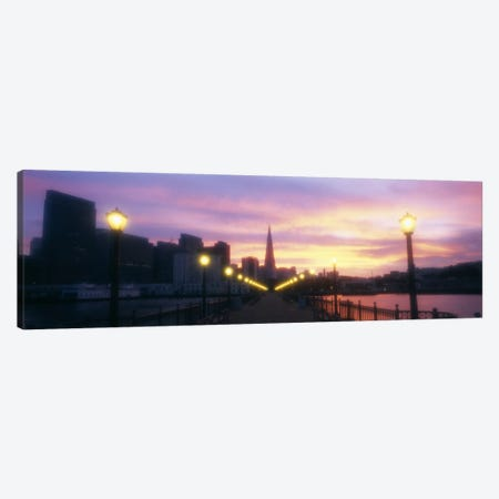 Illuminated lampposts on a pierSan Francisco, California, USA Canvas Print #PIM2938} by Panoramic Images Art Print