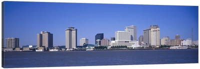 Buildings at the waterfront, Mississippi River, New Orleans, Louisiana, USA Canvas Art Print