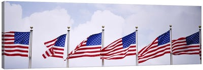 Low angle view of American flags fluttering in wind Canvas Print #PIM3005