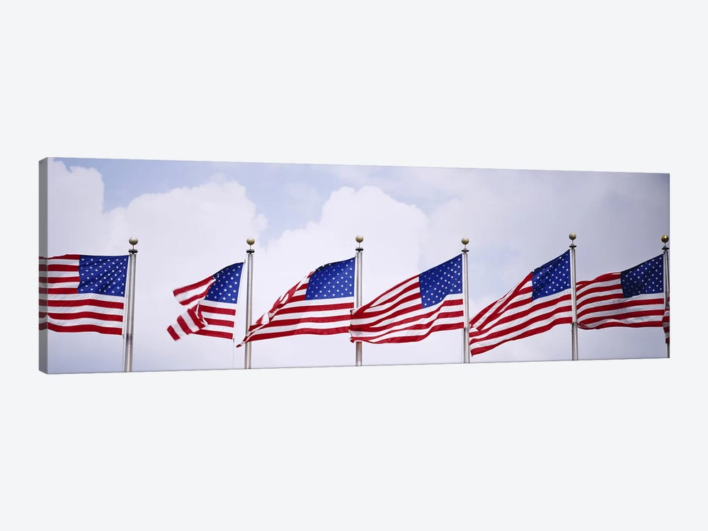 Low angle view of American flags fluttering in wind by Panoramic Images 1-piece Canvas Print