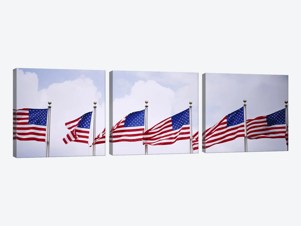 Low angle view of American flags fluttering in wind by Panoramic Images 3-piece Canvas Print