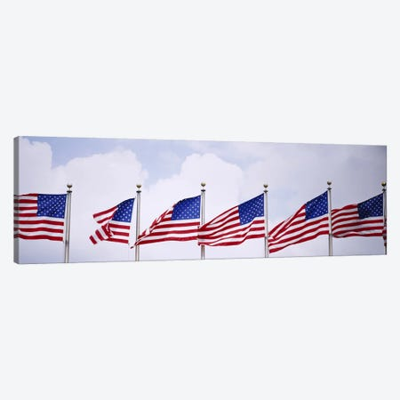 Low angle view of American flags fluttering in wind Canvas Print #PIM3005} by Panoramic Images Canvas Art Print